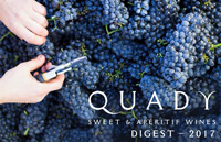Quady Sweet and Aperitif Wines digest cover page with image of hands holding garden shears over bunches of red grapes.
