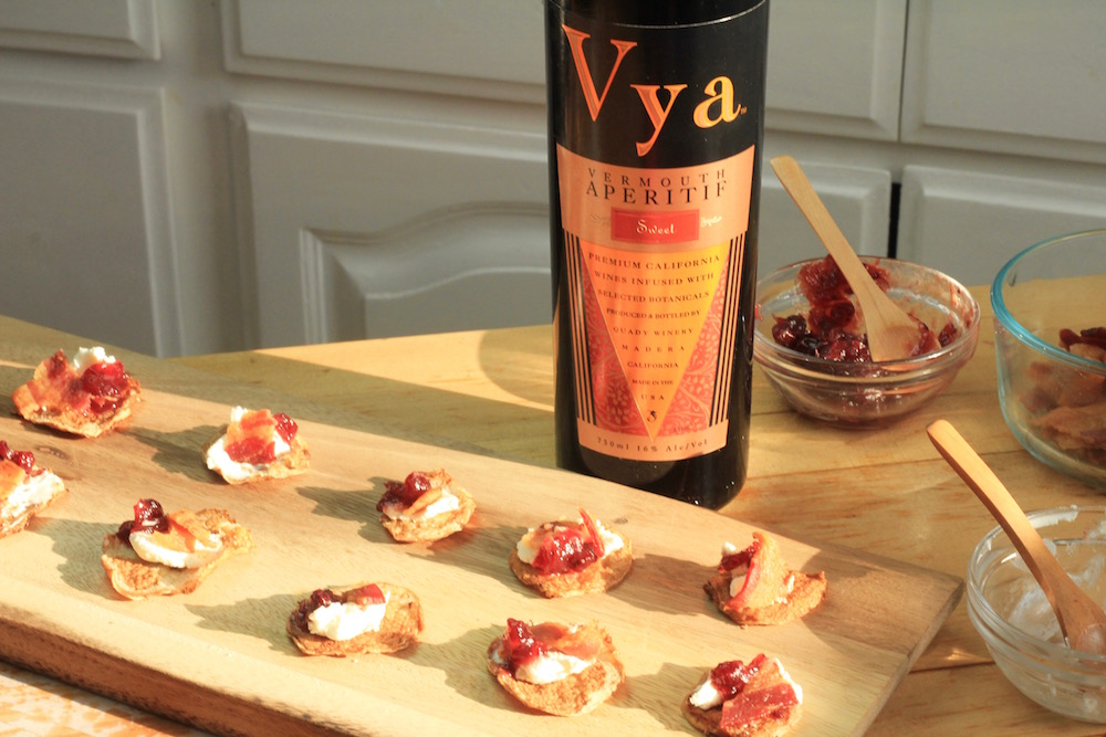 Cauliflower Bacon Fritters with Bacon next to a bottle of Vya Sweet Vermouth.
