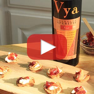 Play button over an image of Vya Sweet Vermouth and a cauliflower appetizer.