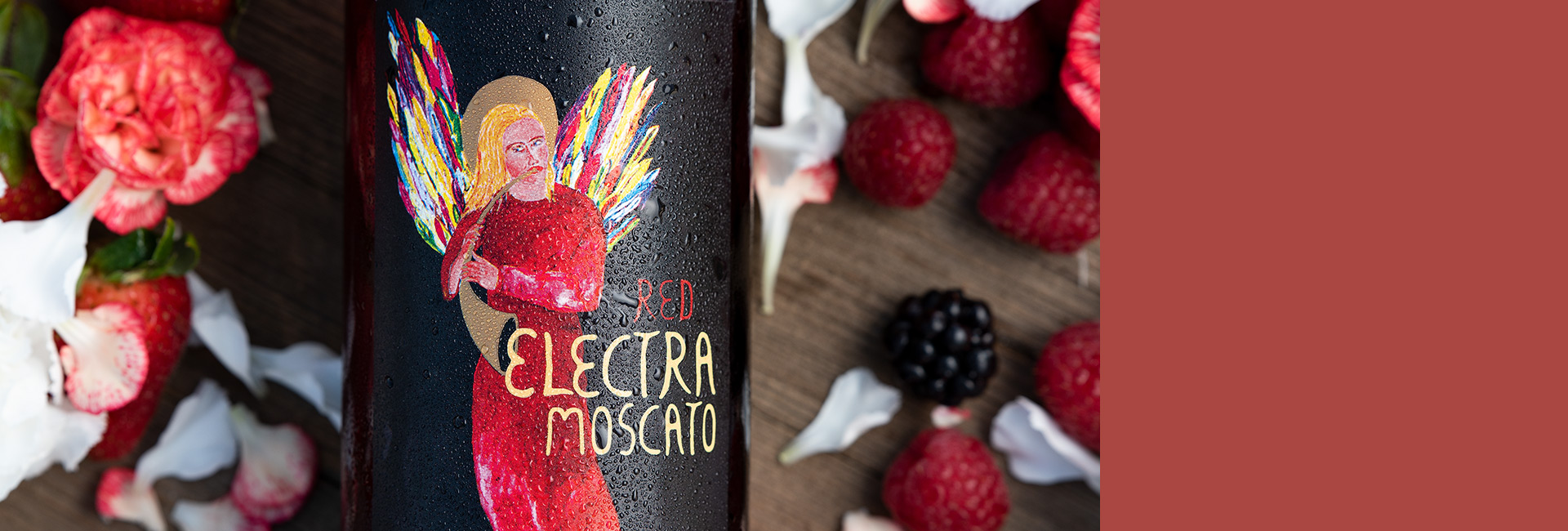 Red Electra Moscato Wine with new label and packaging surrounded by flowers, raspberries and strawberries