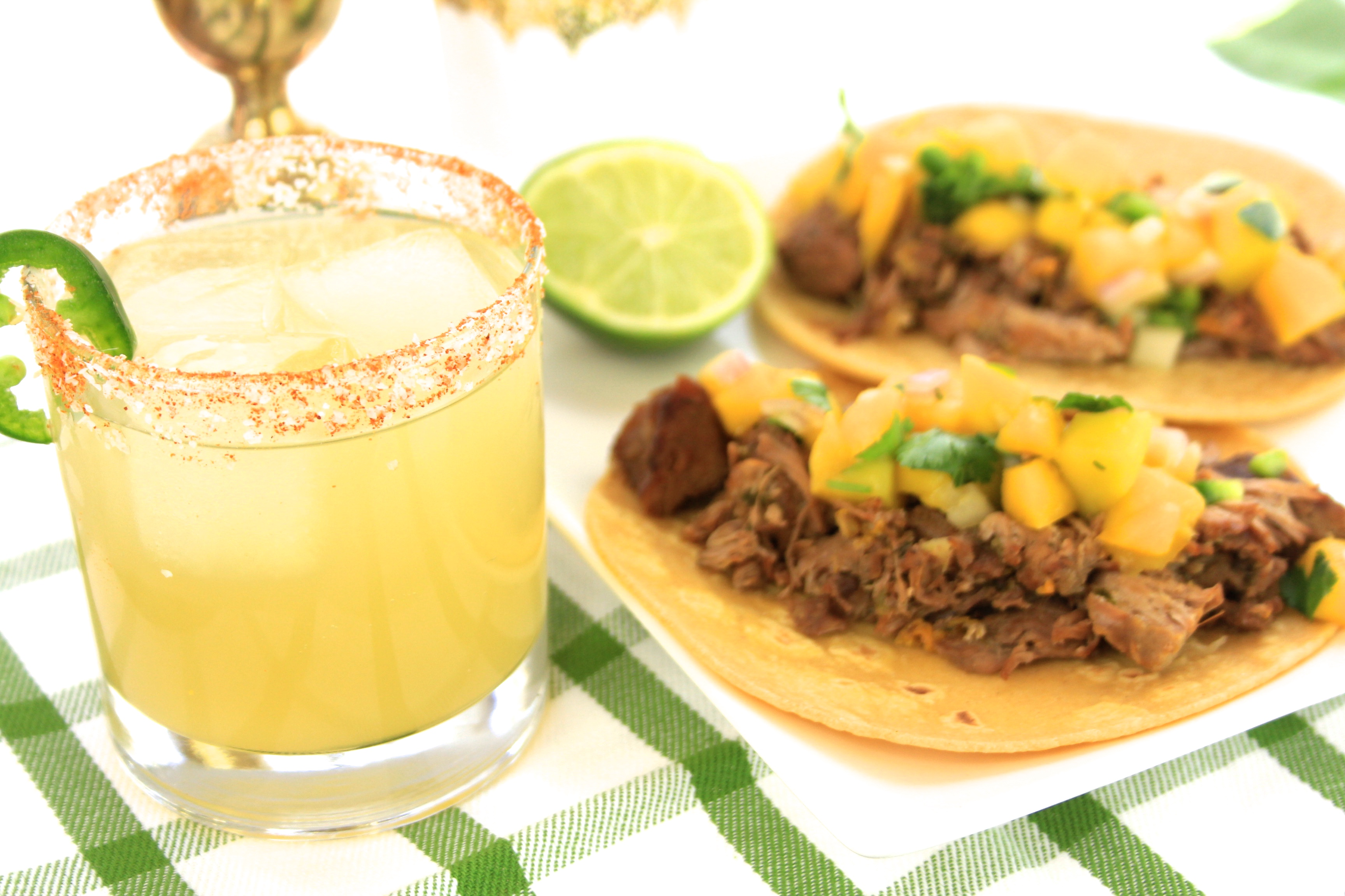 Spicy Apricot Margarita recipe paired with Killer Carnitas Tacos and Mango Salsa for Cinco De Mayo celebration