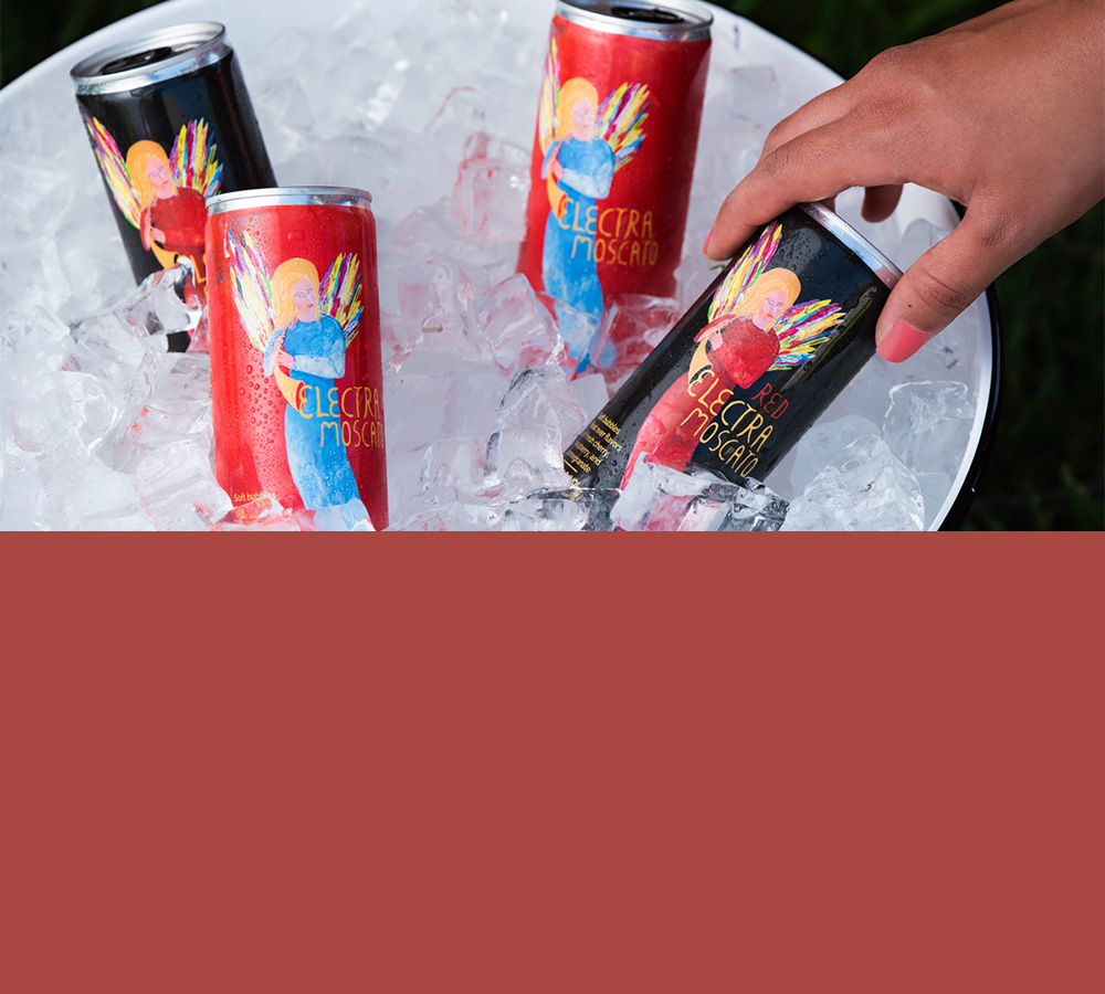 Hand reaching for Electra Moscato cans in an ice bucket - mobile version