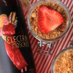 Red electra Moscato Bottle with No Bake Cheese Cake strawberries and flowers
