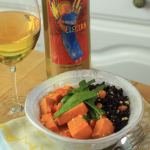 Dish of Creamy Sweet Potato Curry paired with a glass of Quady Electra Moscato