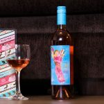 A bottle and glass filled with Quady Winery's new Electra Moscato Rosé