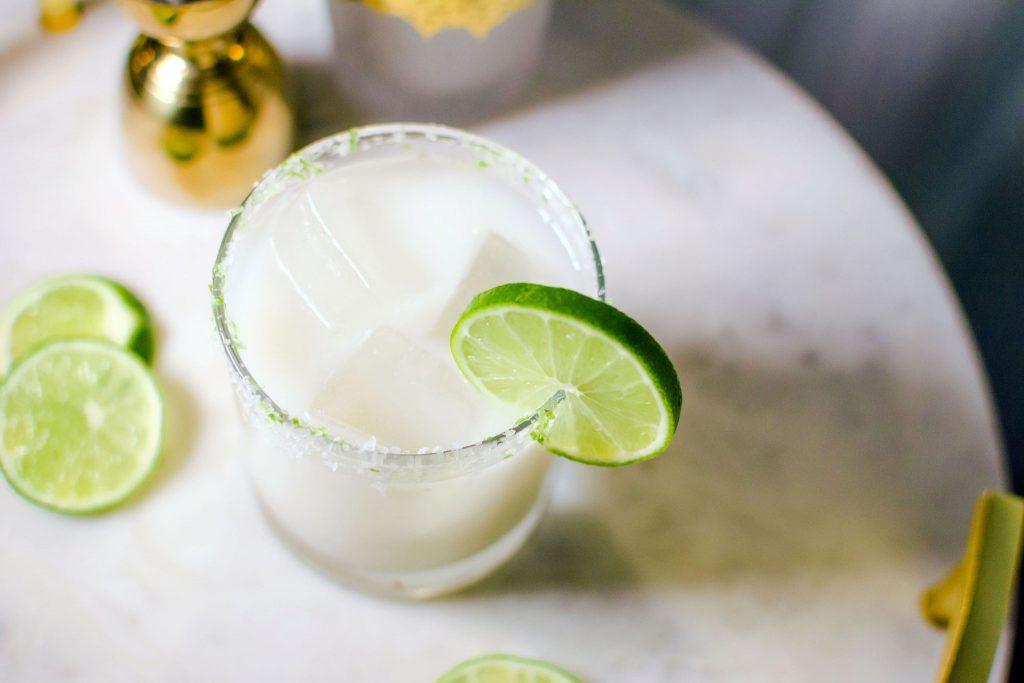 Quady Coco-Cream Margarita Recipe with Essensia Orange Muscat, coconut cream and Tequila in a rocks glass with a lime wheel garnish