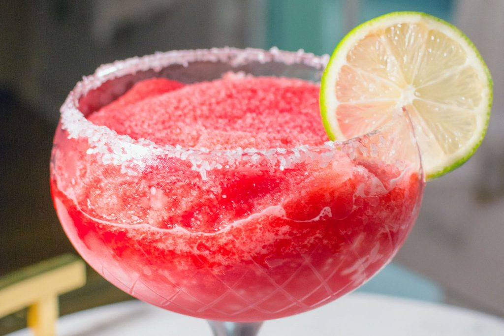 Red Electra Moscato-rita Moscato Margarita wine cocktail in a glass with lime garnish