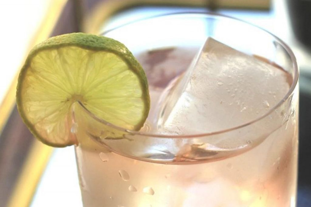 Electra Rose Moscato-Rita wine cocktail recipe in rocks glass with lime wheel garnish