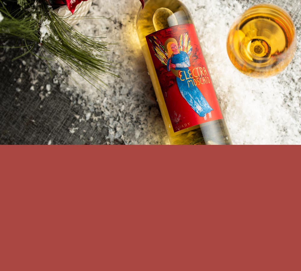 Holiday wine sale mobile banner with a bottle of Electra Moscato lying on a table in snow with a filled wine glass next to it.