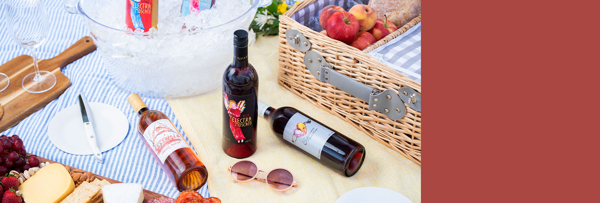 Picnic setting with bottles of Red Electra Moscato, Essensia Orange Muscat dessert wine and Elysium Black Muscat dessert wine.