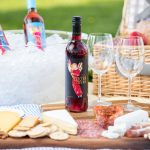 Red Electra Moscato wine in a picnic setting under the spring sun.