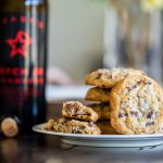 Sarah's famous chocolate chip cookies on a plate next to a bottle of Quady's Starboard Batch 88 port style wine.