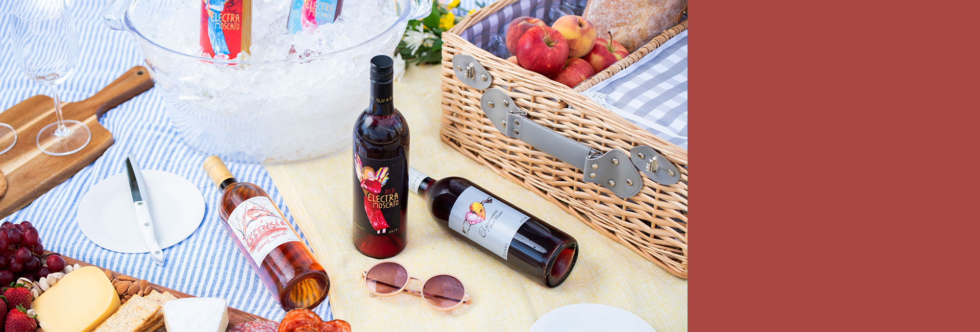Picnic setting with bottles of Red Electra Moscato, Essensia Orange Muscat dessert wine and Elysium Black Muscat dessert wine.