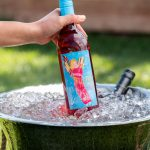 Electra Moscato Rose being put on top of ice with grass behind.