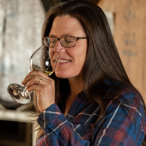 Allison Quady, daughter of Andrew and Laurel Quady, Health and Safety Manager for Quady Winery sipping a glass of Electra Moscato.
